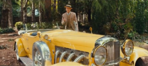 Jay and yellow car The Great Gatsby 2013 - fashion in film.PNG